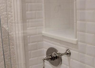 Custom built recessed shower shelving