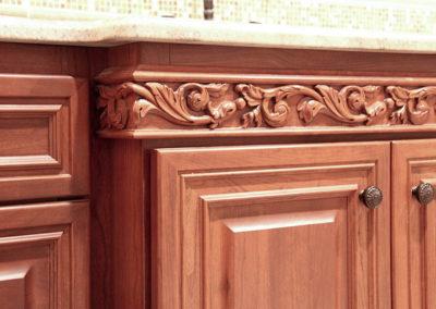 Walnut bathroom vanity with custom carved wood trim