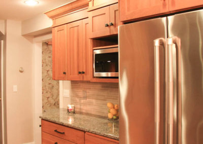 Layers of cherrywood cabinets with beautiful crown molding