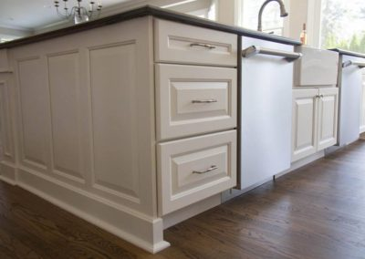Custom side panel on center island to carry cabinet detail throughout kitchen