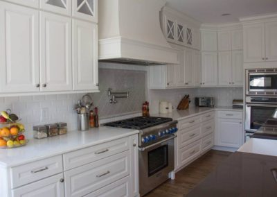 White cabinets with top mullions and crown molding detail