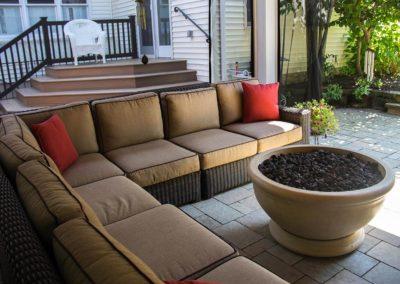 Cozy seating area around Eldorado Stone fire bowl