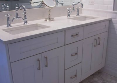 White vanity with double Porcher sinks