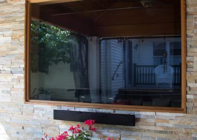 Weather proof tv in stacked stone wall
