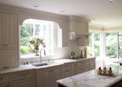 Bright white classic kitchen with quartzite countertops