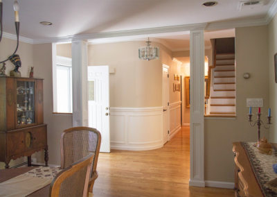 Wainscoting wrapped around hallway wall