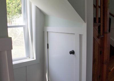 Storage closet under staircase